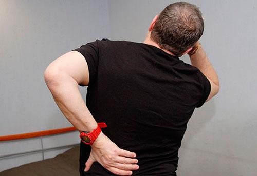Причины боли в пояснице у мужчин